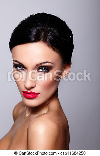 High fashion look.glamor closeup portrait of beautiful sexy Caucasian young woman model with red lips, bright makeup, with perfect clean skin isolated on gray - csp11684250