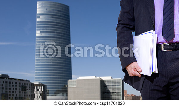 businessman with city background of finance - csp11701820