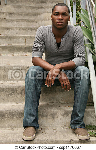 Young African American Male on Stairway  - csp1170667