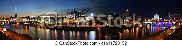 Moscow, Russia. Night. Panoramic view from the embankment of the Moskva River in the Kievsky train station, international business centre and bridges - csp11720152