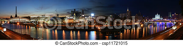 Moscow, Russia. Night. Panoramic view from the embankment of the Moskva River in the Kievsky train station, international business centre and bridges - csp11721015