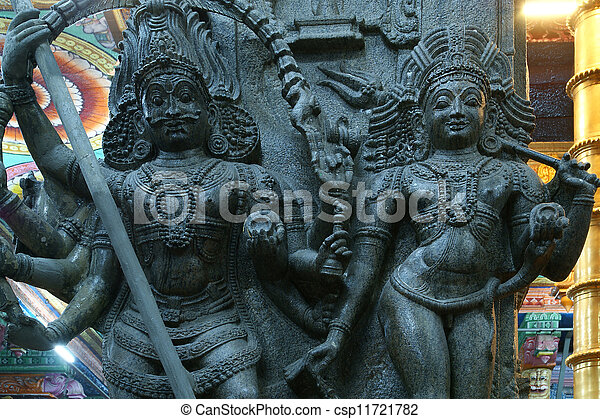 The traditional Hindu religion sculpture. Inside of Meenakshi hindu temple in Madurai, Tamil Nadu, South India. - csp11721782