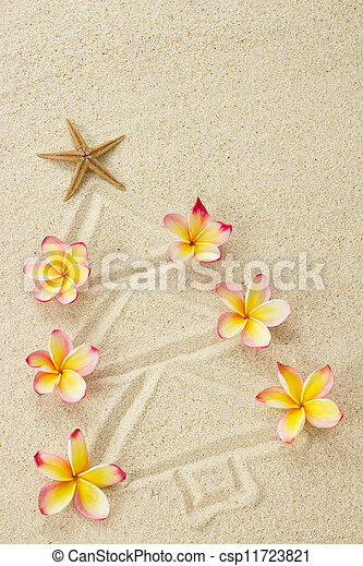Christmas tree made of sand and frangipani flowers. Xmas beach holiday concept  