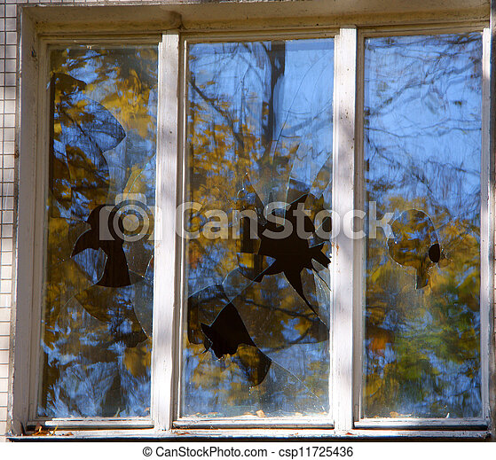 Broken windows of residential homes in close-up - csp11725436