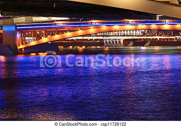 bridges on the river at night with lights reflected in water - csp11726122