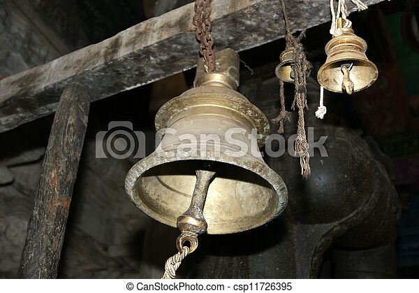 Traditional symbols of the Hindu religion - the bells. Inside of Meenakshi hindu temple in Madurai, Tamil Nadu, South India. - csp11726395