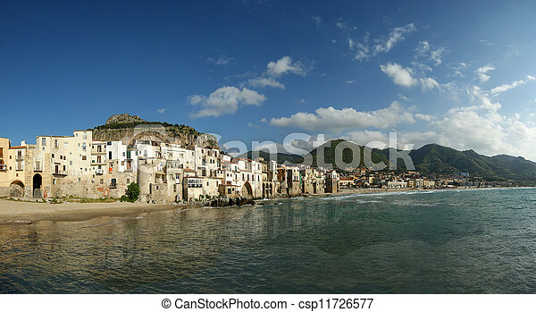 panoramic view of the Cefalu waterfront.  Sicily, Italy. Cefalu is a delicious historic and turistic town in the Palermo's area - csp11726577