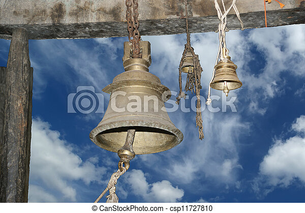 Traditional symbols of the Hindu religion - the bells. Inside of Meenakshi hindu temple in Madurai, Tamil Nadu, South India. - csp11727810