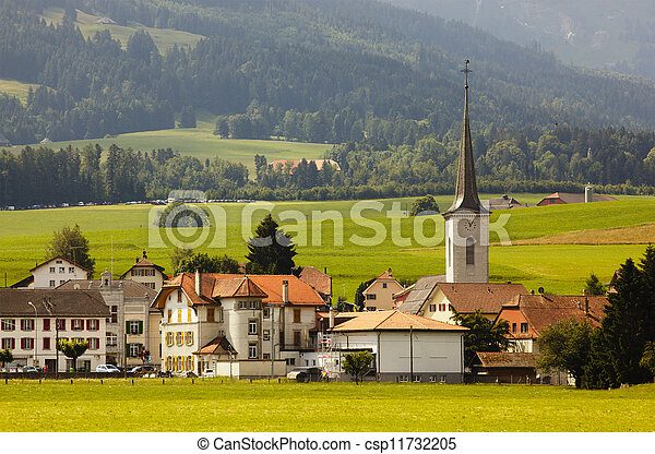 Beautiful view of a valley and church, Switzerland - csp11732205