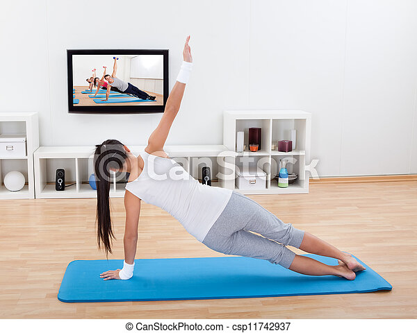 Woman practicing yoga at home - csp11742937