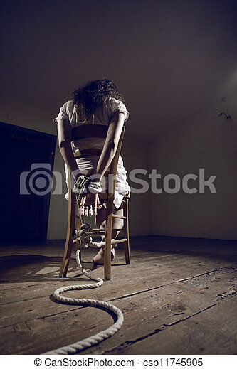 Stock Photography of Woman prisoner - Young woman tied to ...  Stock Photograp...