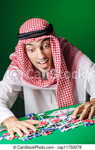 Arab playing in casino - gambling concept with man - csp11750078