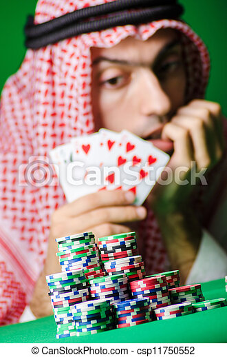 Arab playing in casino - gambling concept with man - csp11750552