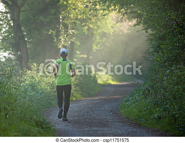 Woman Runner on footpath in countryside