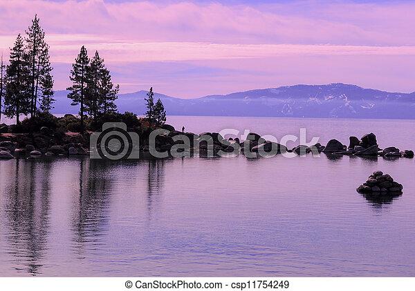 Lake Tahoe, rocks and lake at dusk - csp11754249