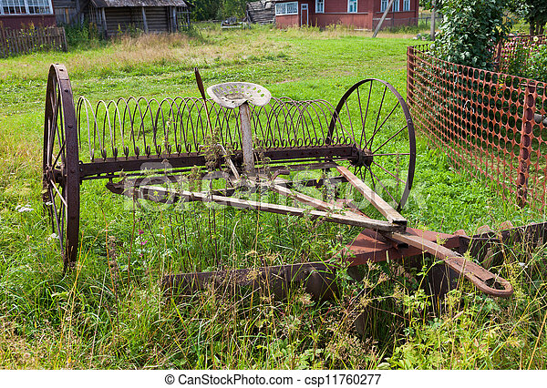 Rake hay in agriculture obsolete model - csp11760277
