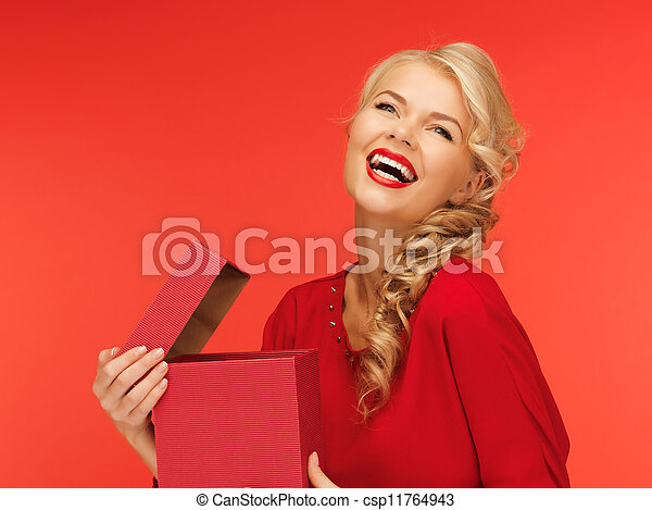 lovely woman in red dress with opened gift box