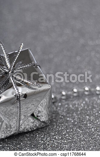 Silver gift box on gray background