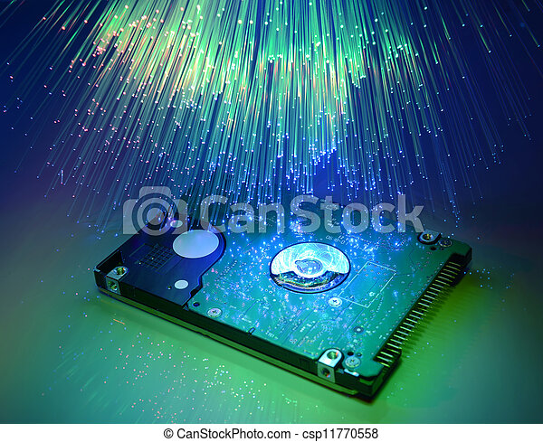 computer harddisk and heads on technology fiber optics background - csp11770558