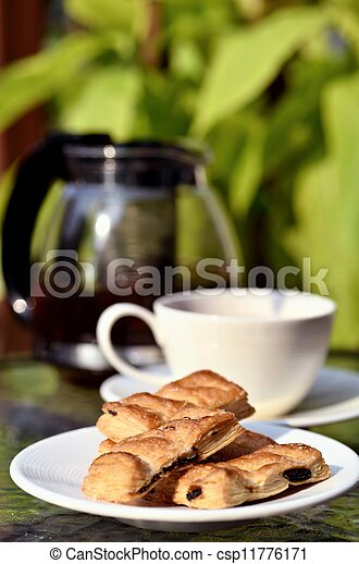 A photo series illustrating a tea break. Tea served with biscuits as the meal.  Taken in outdoor and indoor environment. Great images for food and beverages and can also serve as illustration for rela - csp11776171