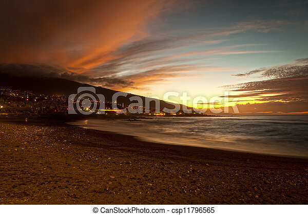 Sunset in Playa Jardin, Puerto de la Cruz, Tenerife - csp11796565