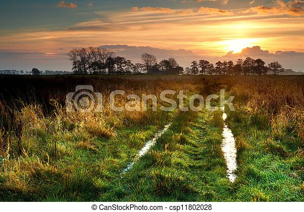 sunrise over rural road - csp11802028