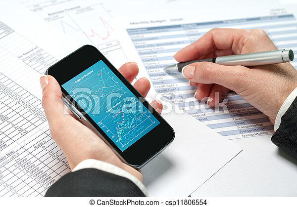 Female hands reviewing accounting on smart phone. - csp11806554