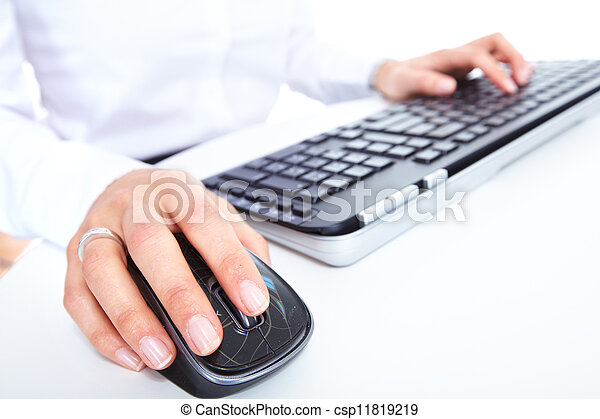 Hand with a computer mouse. - csp11819219
