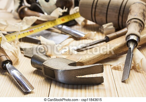 carpenter tools in pine wood table - csp11843615