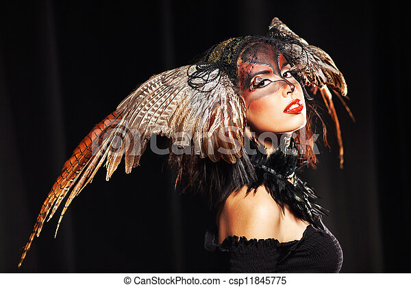 pheasant fantasy hat on beauty head with make-up - csp11845775