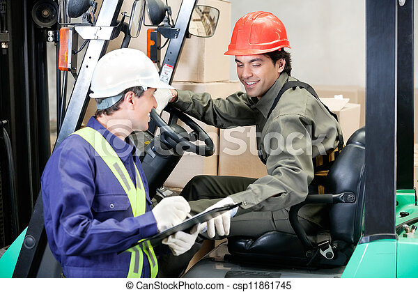 Forklift Driver Communicating With Supervisor - csp11861745