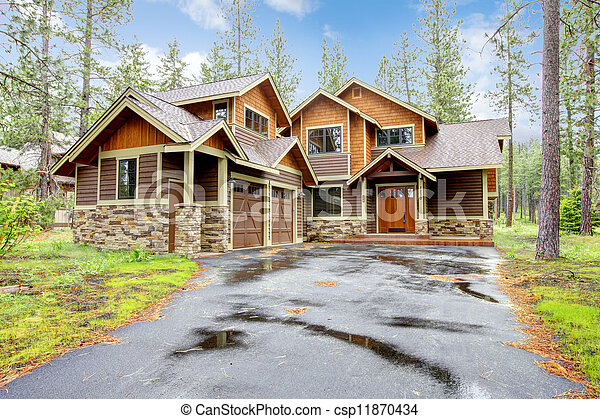 Mountain luxury home with stone and wood exterior. - csp11870434