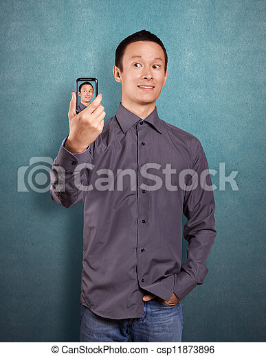 Asian Man Making An Avatar - csp11873896