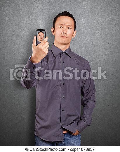 Asian Man Making An Avatar - csp11873957