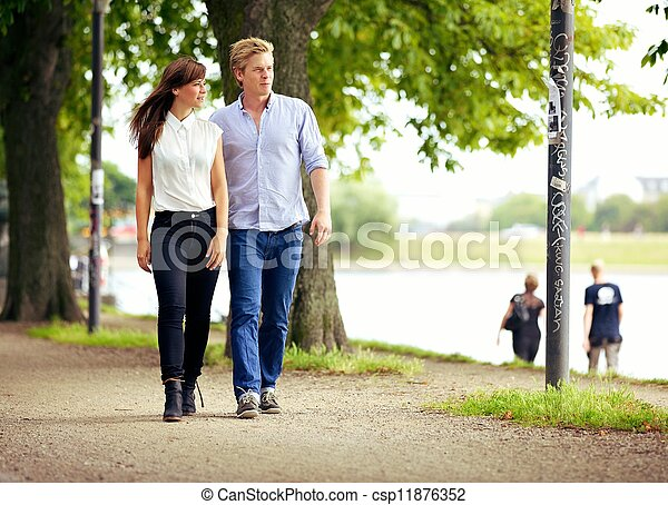 Couple in Love Strolling in a Park - csp11876352
