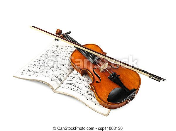Violin and fiddle stick over score - csp11883130