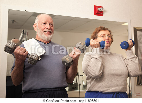 Senior Adult Couple Working Out in the Gym - csp11895501