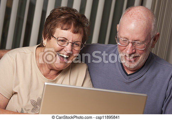 Smiling Senior Adult Couple Having Fun on the Computer - csp11895841