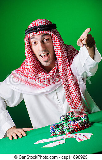 Arab playing in casino - gambling concept with man - csp11896923