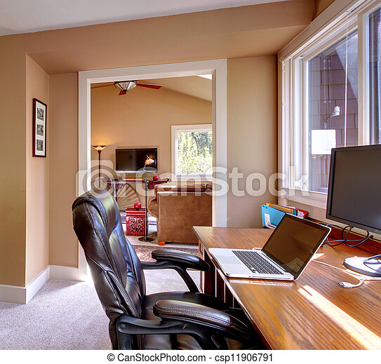 Home office and computer and chair with brown walls. - csp11906791