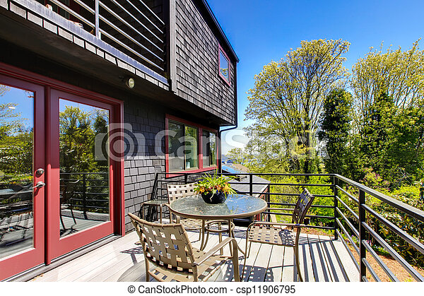 Deck with furniture of Beautiful modern home spring. - csp11906795