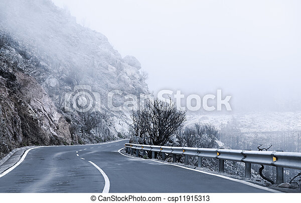 Winter Foggy Winding Road - csp11915313
