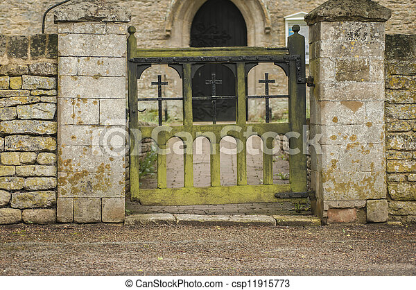 Old decaying wooden Church gate wuth green moss on - csp11915773