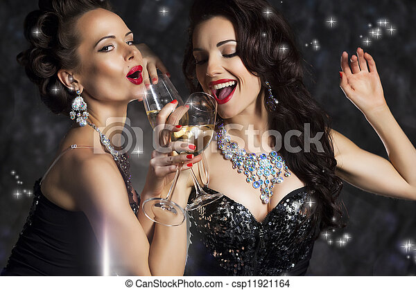 Happy Laughing Women Drinking Champagne and Singing Xmas Song - csp11921164