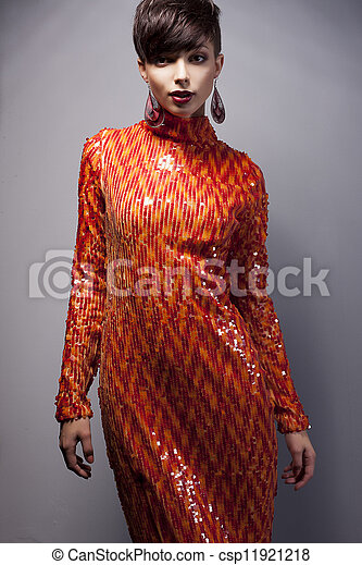 Fashion Style - Luxurious Woman in Red Dress with Strass posing - csp11921218