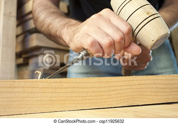 gouge wood chisel carpenter tool working wooden background - csp11925632