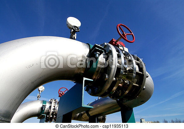 Industrial zone, Steel pipelines and valves against blue sky - csp11935113