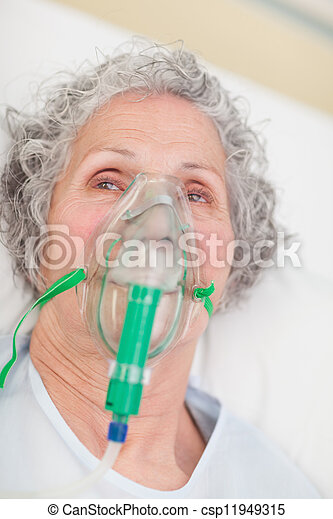 Elderly woman with an oxygen mask in a hospital - csp11949315