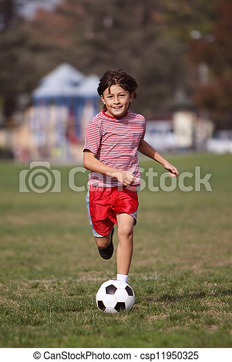 Boy playing soccer in the park  - csp11950325