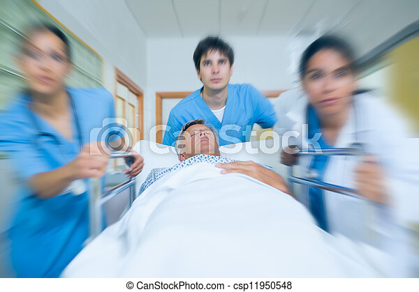 Team of doctor running in a hospital hallway - csp11950548